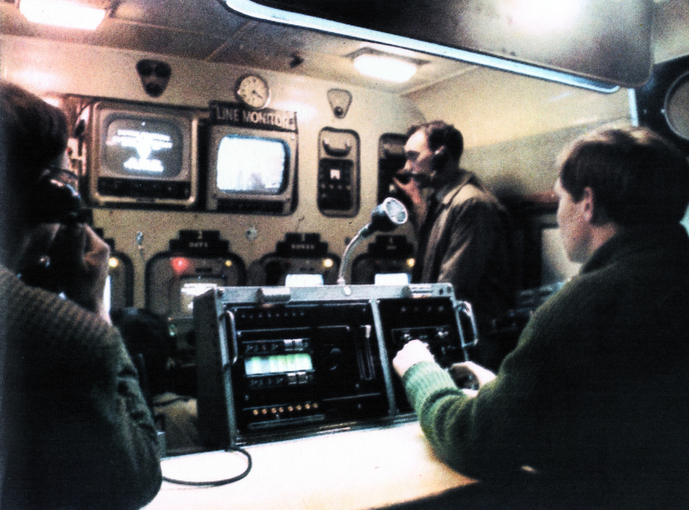 Inside an O.B. scanner; a control suite on wheels. With monitors shared by Vision Control and Production, lack of space demands real compatibility. But careful planning has given ABC scanners almost as much flexibility as their studios, and contributed to a keen team-sense in the crews.